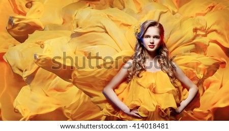 Fashion Model Young Woman, Girl on Waving Fabric Background, Yellow Dress - stock photo