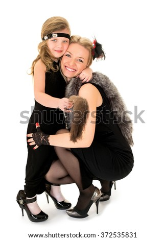 Fashion mom and daughter - stock photo