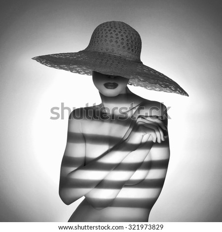 fashion monochrome portrait of sexy naked woman in hat. nude girl - stock photo