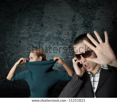fashion ninja woman and her screaming bodyguard - stock photo