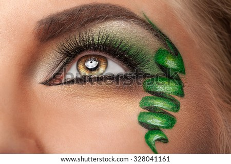 Fashion on stage make up with whirl at the eye. Close up shooting. Beauty and fashion. Glamour and on stage make up. Make-up art - stock photo