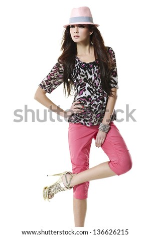 fashion or casual woman in hat posing studio - stock photo