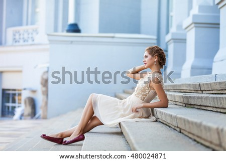 fashion outdoor photo of beautiful sensual woman in luxurious dress