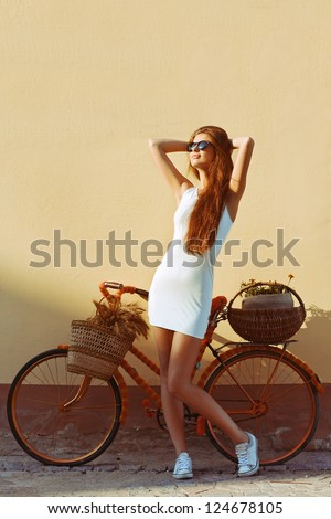 Fashion outdoor portrait of young attractive brunette. Spring morning colors. - stock photo