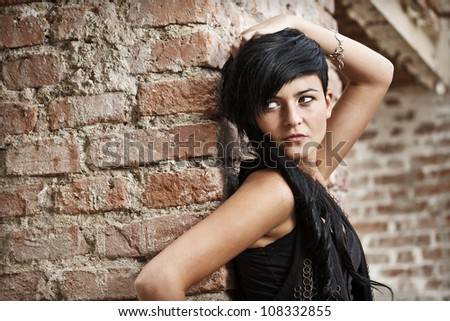Fashion outdoor portrait of young sexy woman - stock photo