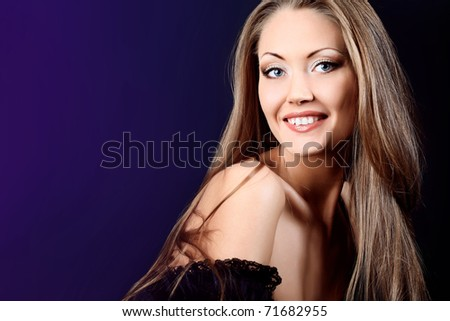 Fashion photo, beautiful model is posing over black background - stock photo
