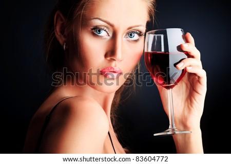 Fashion photo, beautiful model is posing over black background - stock photo