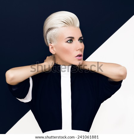 Fashion photo. blond model with trendy hairstyle.asymmetrical design - stock photo