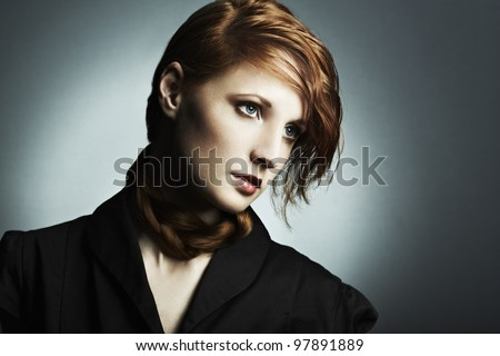 Fashion photo of a beautiful young red-haired woman. Close-up portrait