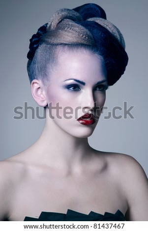fashion photo of attractive young woman with styled hair - stock photo