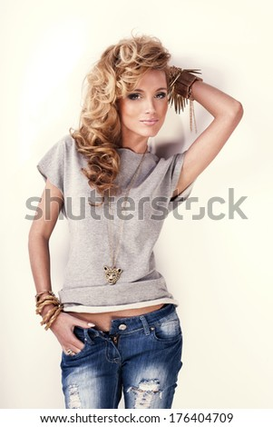 Fashion photo of beautiful blonde woman with curly hair posing. - stock photo