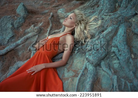 Fashion photo of beautiful lady and mighty tree - stock photo