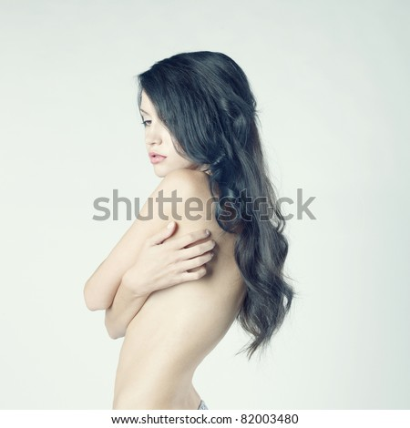 Fashion photo of beautiful nude woman with long dark hair - stock photo