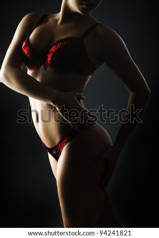 Fashion photo of beautiful  woman in red lingerie - stock photo