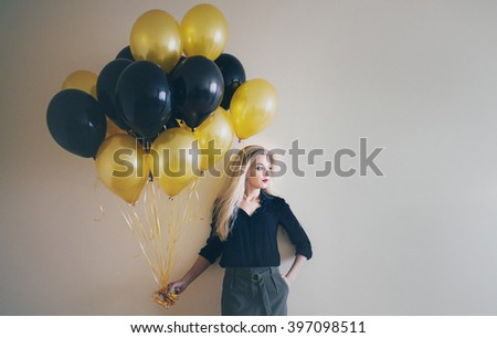 Fashion photo of beautiful woman with balloons. Girl posing.  - stock photo