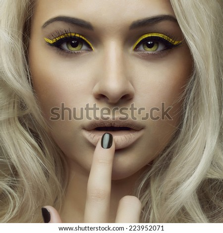 Fashion photo of beautiful woman with bright makeup - stock photo