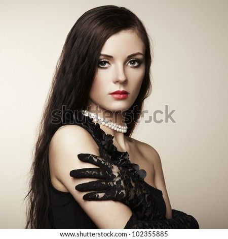 Fashion photo of beautiful woman with magnificent hair. Studio portrait - stock photo