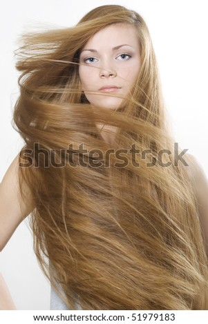 Fashion photo of beautiful woman with magnificent long blond hair - stock photo