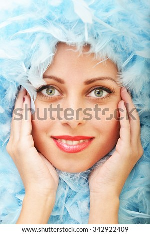 Fashion photo of beautiful women under blue feathers. Beauty portrait - stock photo