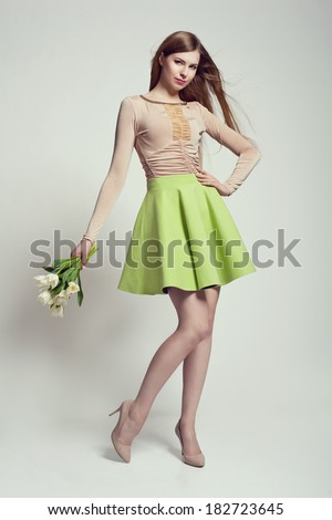 Fashion photo of beautiful young woman with flowers - stock photo