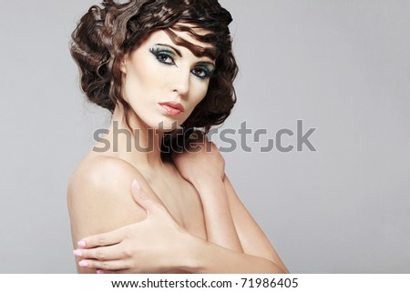 Fashion photo of beautiful young woman with magnificent hair. - stock photo