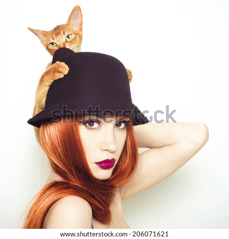 Fashion photo of elegant lady with Abyssinian cat - stock photo