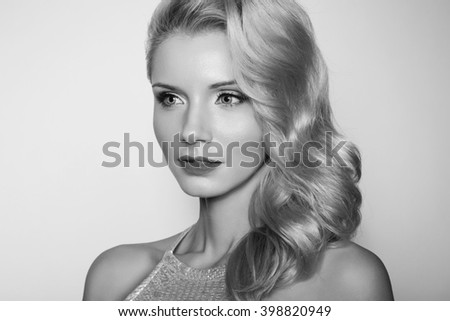 Fashion photo of luxury blonde with a gift.Black and white photo.
