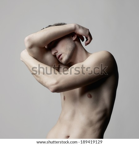 Fashion photo of naked male with strong body - stock photo