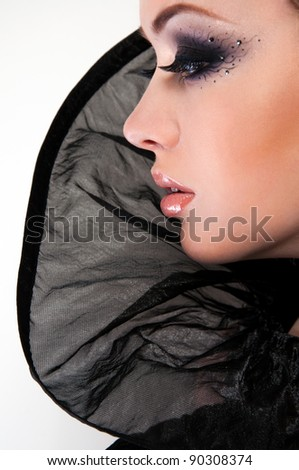 fashion photo of pretty blond woman in creative black dress - stock photo