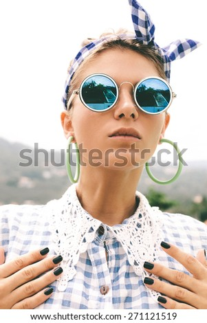Fashion photo of sexy beautiful Girl in plaid shirt and sunglasses. Outdoors lifestyle portrait