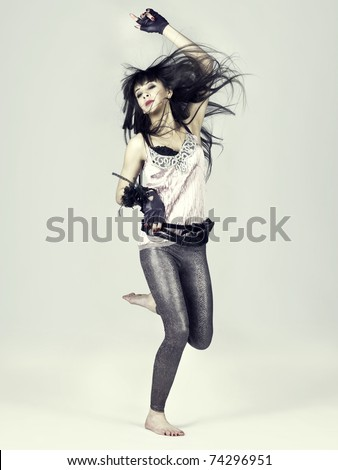 Fashion photo of sexy young beautiful girl in jump - stock photo