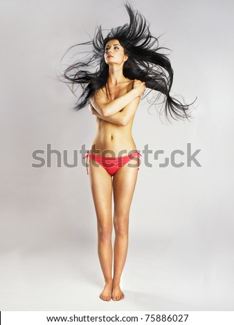 Fashion photo of young beautiful woman with magnificent hair - stock photo