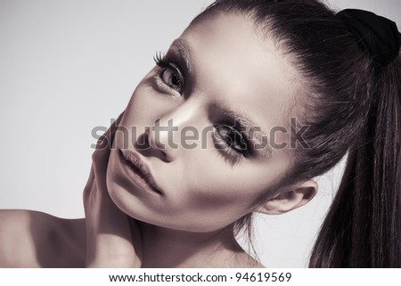 Fashion photo of young brunette woman with ideal skin and beautiful make-up