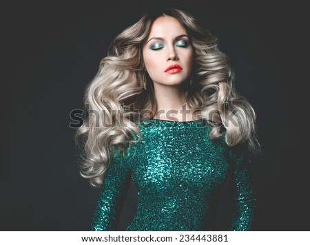 Fashion photo of young gorgeous woman in sequined dress - stock photo
