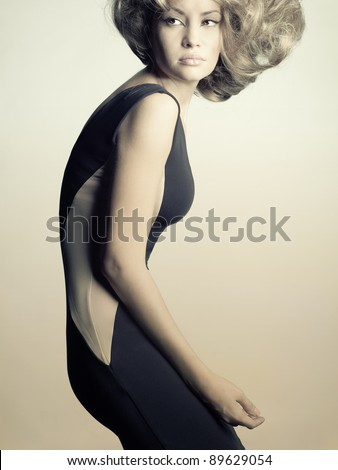 Fashion photo of young lady in elegant black dress - stock photo