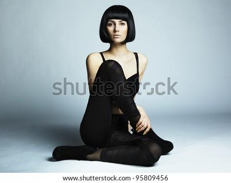 Fashion photo of young long-legged woman - stock photo