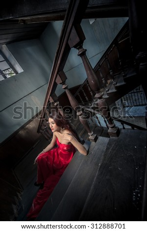 Fashion photo of young magnificent asia woman in red dress