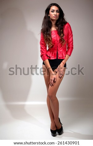 Fashion photo of young magnificent woman. Girl posing. Attractive sexy brunette woman posing.Studio photo