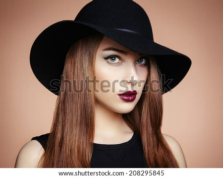 Fashion photo of young magnificent woman in hat. Girl posing. Studio photo.  Perfect Makeup - stock photo