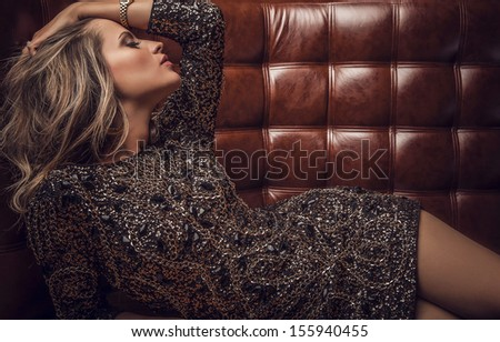 Fashion photo of young magnificent woman in luxury dress.  - stock photo