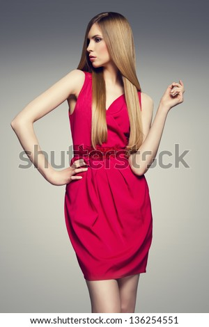 Fashion photo of young magnificent woman in red dress. - stock photo