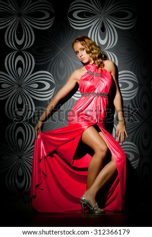 Fashion photo of young magnificent woman in red dress