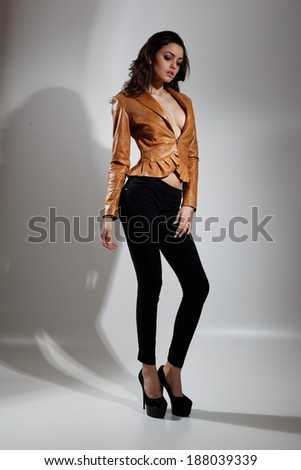 Fashion photo of young magnificent woman.Studio photo