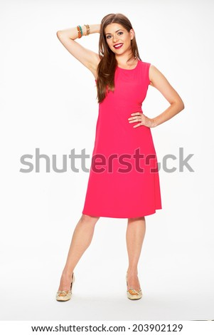 Fashion photo of young model in red dress. Full length portrait of smiling woman. White background.