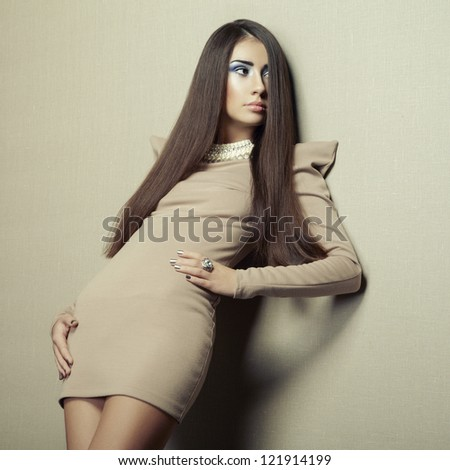Fashion photo of young sensual woman in beige dress. Fashion photo - stock photo