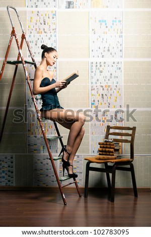 Fashion photo of young sexy woman in shabby interior - stock photo