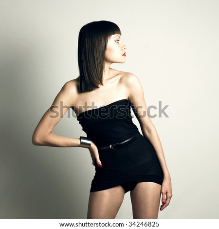Fashion photo of young slender woman in fashionable swimming suit - stock photo