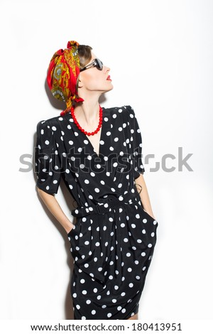 Fashion photo of young style woman posing. studio shot - stock photo