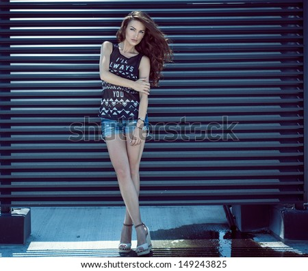 Fashion photo of young woman - stock photo