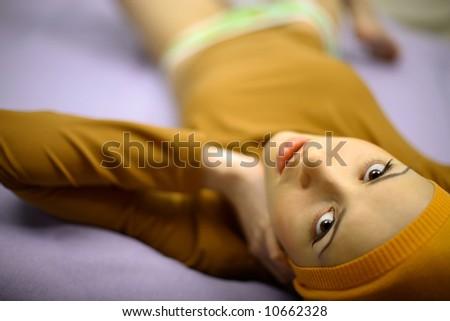 Fashion photo of young woman in orange bandage - stock photo